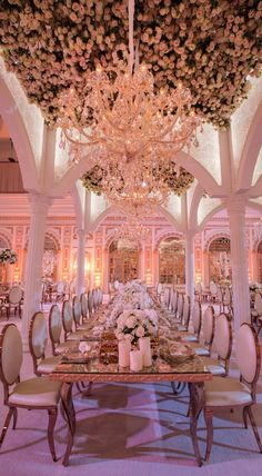 Gorgeous tablescape and check out all the flowers on the ceiling!  Goes to show you that event design doesn't have to be limited to eye-level attention to detail