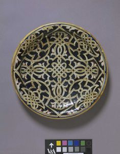 Knotwork Plate Maiolica, 1537 Place of origin: Gubbio, Italy (finished) Date: 1537 (dated) Artist/Maker: Giorgio Andreoli, born 1465 - died 1555 (final firing, potter) Materials and Techniques: Tin-glazed earthenware (maiolica) Museum number: 6864-1860
