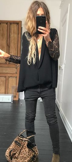 #spring #outfits black and gray plunging neckline with black fitted jeans. Pic by @meleponym
