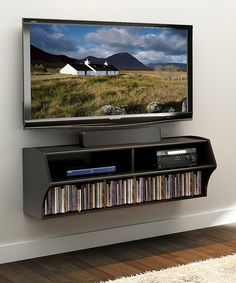 This mountable wall console is perfect for displaying a widescreen television and storing essential media accessories. It comes ready to assemble and includes an easy-to-follow instruction manual, so adding contemporary convenience to any room is a cinch.48.5'' W x 16.75'' H x 16'' DCARB-compliant composite woodAssembly...