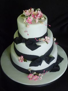 wedding cake I made..flowers edible and ribbons fondant
