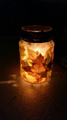 Diy autumn mason jar. Decorated with natural leaves and mode podge. The result was incredible!
