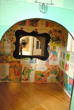Cardboard box house with decoupage children's book pages inside, and a little dollarstore mirror.