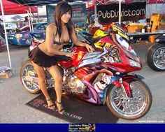 Hot babe with a Honda CBR1000RR motorcycle! - Honda CBR1000RR - ID: 580759