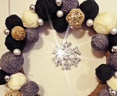 Yarn and twine wreath with glittery snowflake in the center  MERRY CHRISTMAS!