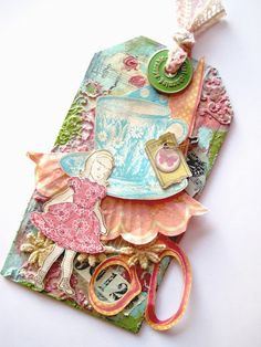 collage tag with texture paste and paint, stamped images and emphera by Laura Turner