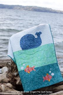 Splash! Fun modern baby quilt with adorable appliquéd whale and fish. Easy to follow instructions and templates included in the pattern along with a guide for big stitch style quilting with pearl cotton. This quilt was made with Clothworks Fresh Batiks and includes yardage for batik fabrics. Add this pattern to Facebook, Twitter or Pinterest using the buttons below. Continue Shopping