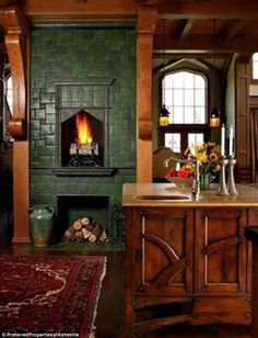 A green fireplace! I love the idea of splashes of color here and there! Beautiful kitchen fireplace with green tile (Andie MacDowell's Storybook Tudor in NC) Tudor House, D House, Tiny House, Tudor Cottage, Style At Home, Tudor Kitchen, Craftsman Kitchen, Cozy Kitchen, Kitchen Ideas