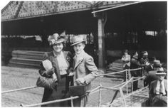 A Jewish refugee couple poses on the gangway of the SS St. Louis as they disembark from the ship in Antwerp.
