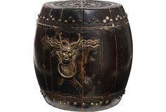 Elm barrel with carved floral motif on lid and lion handles.