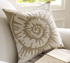 A more neutral accent of a spiral shell,  another great summer throw pillow