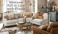 Living room : Rustic romance . Love the floral + Southwest pillow mix