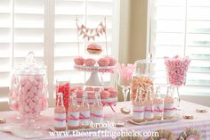 Pink party: pink strawberry marshmallows, pink and white cotton candy, strawberry salt-water taffy,  bubble gum flavored rock candy, grapefruit sours, white chocolate popcorn drizzled with pink candy melts and strawberry cupcakes with pink frosting