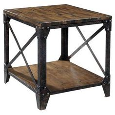 """Distressed natural pine wood end table with a lower shelf and iron frame.   Product: End tableConstruction Material: Hardwood solids, pine veneer and metalColor: Natural and blackDimensions: 24"""" H x 22"""" W x 26"""" D"""
