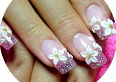 Beautiful example of free hand 3D floral nail art with white daisy flowers, Daisies, on pink glitter French style tips with nude nail Link: 27 Modern Floral Nail Designs