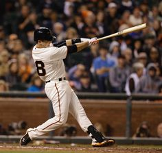 San Francisco Giants' Buster Posey swings for the game-winning home run off Colorado Rockies' Juan Nicasio in the ninth inning of a baseball game Wednesday, Aug. 27, 2014, in San Francisco. The Giants won 4-2. (AP Photo/Ben Margot)