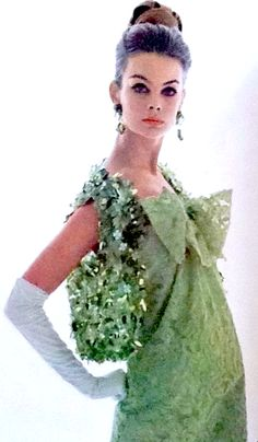 Green vintage fashion on model Jean Shrimpton photographed by David Bailey for Vogue Paris, 1963.