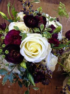 White Roses, Queen Anne's Lace, Variegated Pittosporum, Lisianthus, Privet and perfectly plum ranunculus.