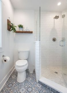 The bathroom door of this Chicago shabby chic studio loft is salvaged wood, the mirrors antique, yet the shower fixtures are all the latest from Grohe. | Chi Renovation & Design #ChiRenovation - www.chirenovation.com
