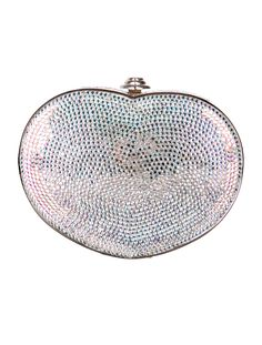 Silver and multicolor Judith Leiber heart-shape Minaudière with rainbow crystal embellishments throughout, drop-in chain, silver lining and black heart push-lock closure at top. Includes signature accessories; comb, coin pouch and mirror with dust bag. Includes authenticity card, product registry card and dust bag. Shop Judith Leiber new and pre-owned designer handbags at The RealReal.