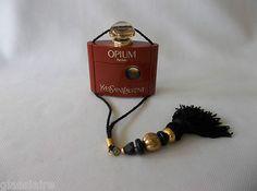Vintage Yves Saint Laurent tasseled perfume bottle.