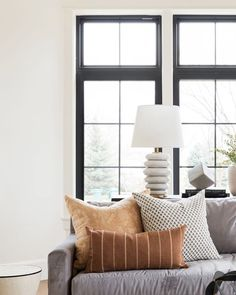 A perfectly balanced light feature, the P H O E B E Stacked Table Lamp by @kellywearstler is a ceramic lamp resembling beautiful stacked pebbles, a simple yet effective way to add a touch of nature to your space 🌿 stock arriving to Bloomingdales now! 👉 - @visualcomfortco Light Gray Couch, Dark Grey Couches, Beige Couch, Living Room Pillows, New Living Room, Couch Pillows, Living Room Decor, Cushions, Throw Pillows
