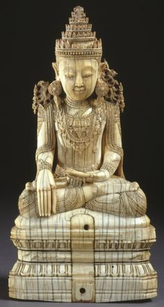 Figure of crowned Buddha seated in bhumisparsamudra and set on a throne decorated with lotus petals. The central part of the throne has a section which has been replaced with an undecorated slip of ivory. Made of carved ivory.  Burma 18thC