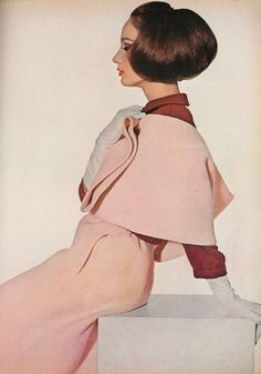 March Vogue 1964. Model is wearing a pale peach double woven wool tweed suit.