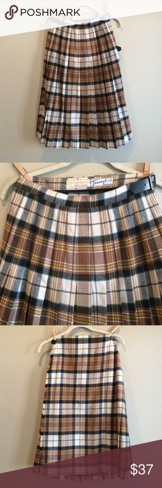 """Vintage Scottish Plaid Kilt and Scarf Set I love the neutrals of this plaid!  This vintage kilt was made in Scotland by Kinloch Anderson and sold by Trimmingham's Bermuda. No size or material tags but this is almost certainly 100% wool. Pleated front and wrap style with 2 buckle closure. Measures approximately 13.25"""" across flat waist and 27"""" in length. This also comes with a matching scarf as shown in last pic. Scarf measures approx 13"""" x 71"""" excluding fringe. Both pieces are in great…"""