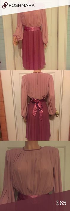 Gorgeous Vintage Pleated Purple/Pink Dress w Satin Gorgeous Vintage Pleated Purple/Pink Dress w optional fuchsia Satin Belt you can tie in many different ways. It's Amazing. Could wear with other belts or without a belt at all. The designer is Jackie Taub for Connections. There are Pearl Buttons on the top back of dress to fasten but and on both wrists. Has shoulders pads sewn Measurements are coming as there is no size tag. It fits like an 8-10 but go by measurements. Waist is elastic…