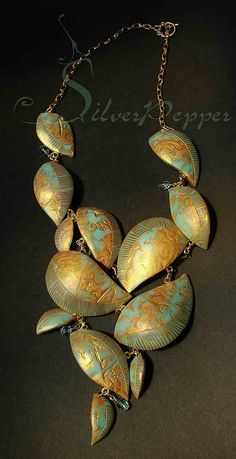 "Necklace ""Versailles   Could copy in pollymer clay, Embed some faux gold leaf, and then  patina."