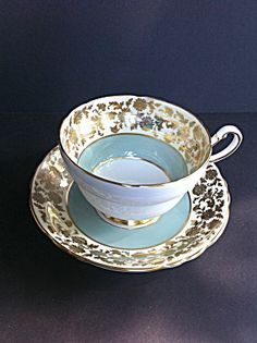 PARAGON FINE BONE CHINA TURQUOISE Tea Cup and Saucer. so so so pretty...can I have a set please?