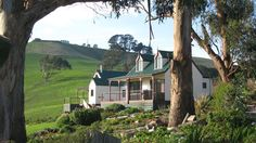 Overlooking the spectacular hills and valleys of South Gippsland, the luxurious Loves Lane Cottages feature extensive landscaped gardens and free on-site. Hills And Valleys, Dormer Windows, Green Valley, Lush Green, Melbourne, Condo, Exterior, Australia, Mansions