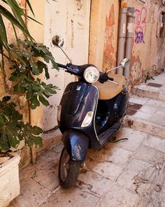 TITLE: Navy Blue Vespa  LOCATION: Corfu, Greece        Loving the classic color combination on this Vespa in Corfu Greece.