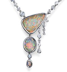 """Patrick Pertat """"Tears of Thetis"""" Meeting between fire and ice, between incandescent lava colors and mottled shimmer of the iceberg. Patrick Pertat chose to accompany these magical gems diamonds and moonstones to create a cascade of blazing light that will aim to reveal the grace, sensuality and mystery that will bring this gem. Necklace in 18K white gold, opal """"crystal"""" in harlequin effect of 18.30 carats, 5.16 carats and 1.02 carats, moonstone 2.20 carat diamond 2 carats."""