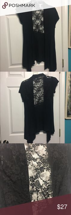 NWOT high low black lace cardigan Never worn. Short sleeve black cardigan. The top of the back side has black see through lace. The front is draped and longer. I'm a size XS-S and bought this long for a longer look to wear with leggings and cover my behind lol Ambiance Sweaters Cardigans