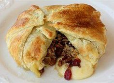 Brie topped with cranberries, toasted cinnamon pecans, and brown sugar all wrapped in a puff pastry. Perfect for your holiday gatherings. 8 servings
