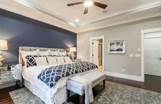 Master bedroom with light gray walls and dark blue accent wall behind tufted bed accent walls, Accent Wall Colors (Design Guide) Navy Accent Walls, Accent Wall Colors, Accent Wall Bedroom, Wall Colours, Blue Master Bedroom, Master Bedroom Makeover, Master Bedroom Design, Master Bedrooms, Blue Bedrooms