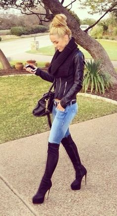 ℒᎧᏤᏋ ℒᎧᏤᏋ everything about her look..from here gorgeous high hair bun down to those knee high boots!!!! ღ❤ღ