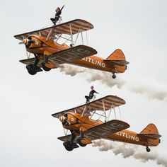 TOP PHOTOS: Aug. 31, 2014 - GalleryTwo Britisch Wingwalkers on biplanes of the Team Breitling perform during a flight at the AIR14 air show in Payerne, Switzerland, Sunday, Aug. 31, 2014. The Air show AIR14 commemorates the 100 year anniversary of the Swiss Air Force.