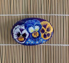 Pansies and Forget me nots hand painted pebble by TheDandyArtist