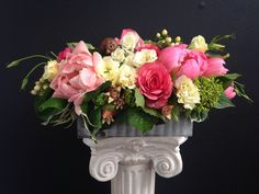 This bright arrangement makes for the perfect centerpiece, table decoration, or everyday gift! Low and long, the arrangement is filled with peonies, roses, lisianthus, hypericum berry and lemon leaf.