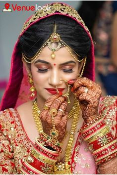 This is yet another one of the most popular bridal poses. Whether you strike a pose adjusting your nath or earrings, there is something so very feminine and unostentatious in this pose. Indian Bride Photography Poses, Indian Bride Poses, Bride Groom Poses, Indian Wedding Poses, Indian Bridal Photos, Indian Wedding Makeup, Wedding Couple Poses Photography, Bridal Photography, Bridal Portrait Poses