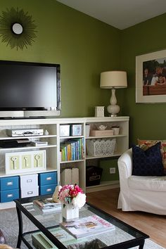 Love this idea of using Ikea bookcases along the wall in Den for TV and putting doors on some of them.