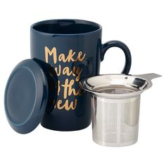 """It's easy to brew your favourite loose-leaf teas at home, work or school with our Perfect Tea Mug. It has a sleek, generously sized profile and an integrated stainless steel infuser for perfectly brewed tea (and no stray leaves) every time. Best of all, it has a beautiful glaze with gold script that reads, """"Make Way for the New."""" It comes boxed for easy gifting. 15.2-oz./450ml capacity. 3.5"""" diameter, 5"""" tall. Porcelain, stainless steel. Dishwasher-safe. Available only at Indigo."""