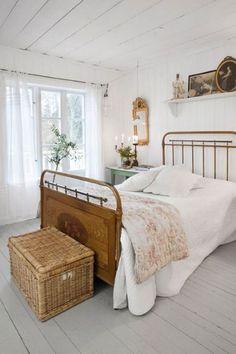 Farmhouse bedroom with wicker trunk