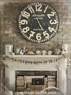 Front Living Area: Vintage summer mantel, love driftwood garland and stacks of books in the fireplace! Painted Fireplace Mantels, Paint Fireplace, Cottage Fireplace, Fireplace Decorations, Farmhouse Fireplace, Brick Fireplace, Vintage Farmhouse, Farmhouse Decor, Big Clocks