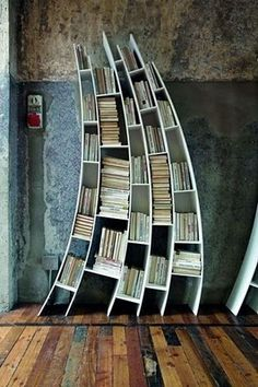 Angled bookshelves (from High Heels and Diet Dr. Pepper)