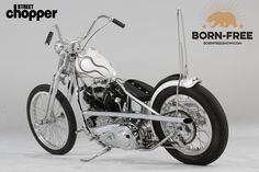 Your Born-Free Bike Build Consists of: My Born-Free 7 Build is a '60s-style chopper, based around a 74-inch Knucklehead motor, four-speed trans, and wishbone frame. I made the pipes, sissy bar, controls, taillight housing, and other bracketry. The wishbone frame has been chromed, and the tank and fender are painted in pearl whites to complement the stainless round stock that is molded into both. The bike has a 4-inch over inline springer, a 21-inch high-shouldered aluminum rim up front…