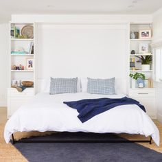 Do you have guests visiting this summer? Kids home from college? Make more room (and stylishly so) with a custom Murphy bed! Schedule a complimentary consultation with a member of our talented design team to discuss all our storage options. Bed Wall, Bedroom Wall, Wall Unit Designs, Bed Designs, Modern Murphy Beds, Guest Room Office, Bedroom Office, Hidden Bed, California Closets